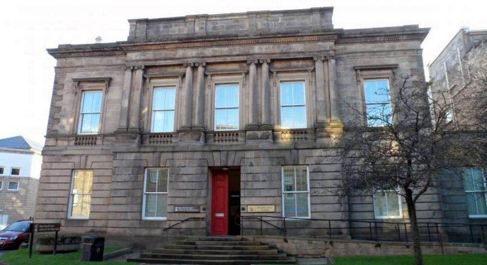 Warring families caused chaos at Elgin Sheriff Court.