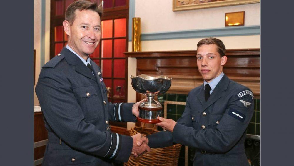 Air Vice-Marshal Gavin Parker OBE presents Lewis with his trophy.