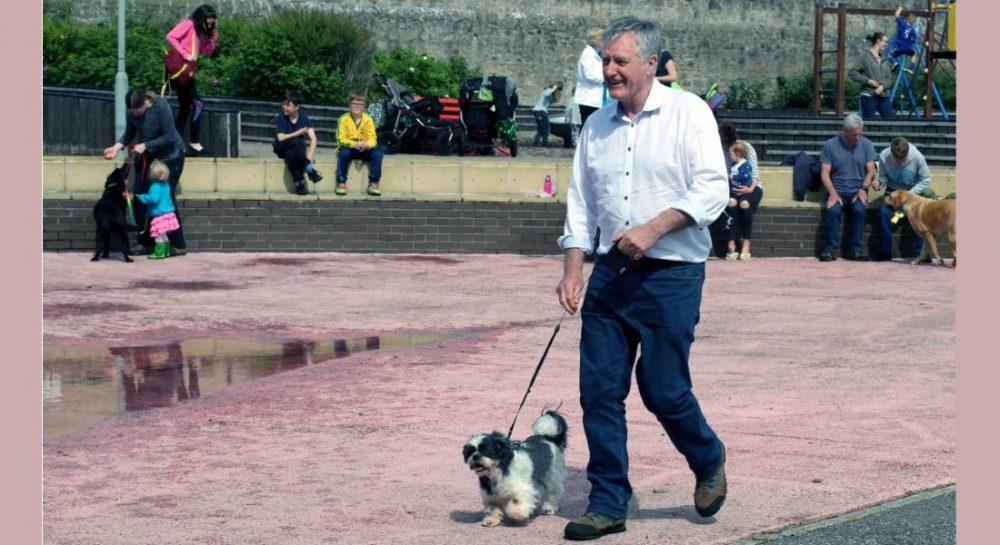 Coco leads Cllr John Cowe to the podium after claiming third in the pet show.