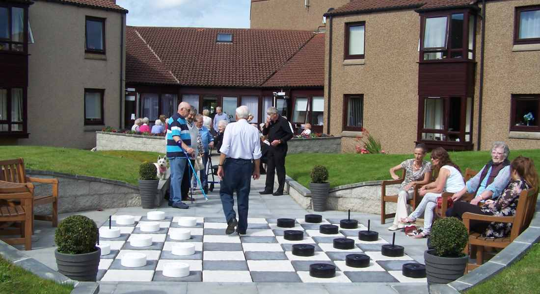 Residents and their guests can now play draughts or go bowling in the new garden.