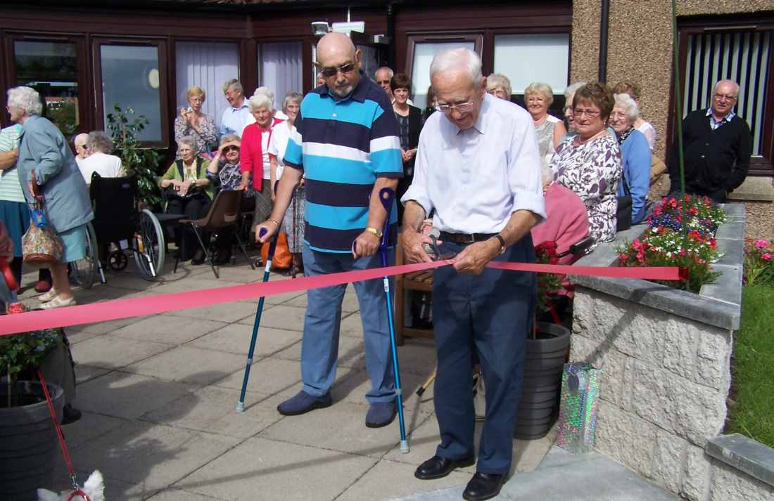 1.Magnus Ingles, one of Burnside Court's oldest and longest residing residents, cutting the ribbon to open the garden.