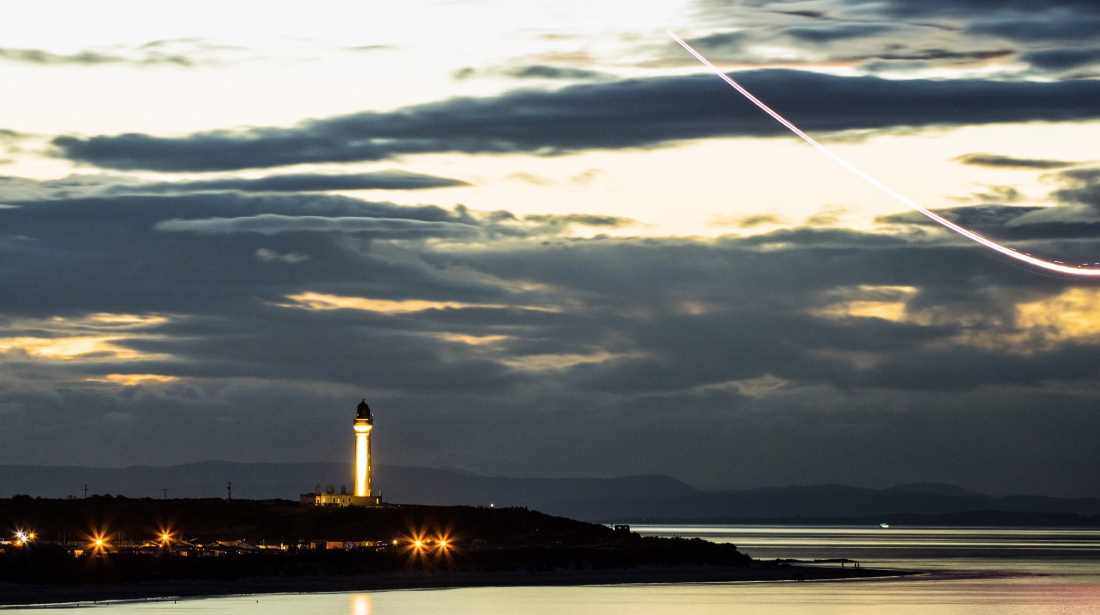 Golden Tribute - the Covesea Lighthouse decked in gold as a Tornado trail is overhead. (Pic: Marc Maloy)
